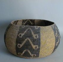 Image of Basket - Food basket of willow and grasses decorated with six rectangles in vertical position of black fern root.