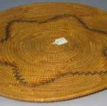 Image of Basket - Basket: tray made of willow reed and devils claw. flat circular basket weave with six sided star design.