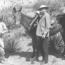 Image of Ba-Keitz-Ogie (The Yellow Coyote), General Cook, and Al-Chi-Say.  Black and white photographic print depicting these three men standing with a horse. Maker's Mark: Baker and Johnston Quantity: 1 Photograph - Photograph