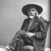 Image of Antonio Lopez.  Black and white photographic reproduction of an 1872 photograph.  Full view of Antonio Lopez sitting in a chair. Maker's Mark: CSPM (reproduction) - Photographs