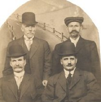 Image of Four Men on a Postcard