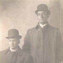 "Image of Two Men in ""Christie"" Hats"