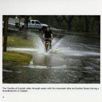 Image of Tim Yantha riding his bike on Gordon Street, page 18