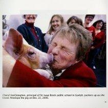 Image of Principal of Sir Isaac Brock School kisses Peneope the pig, 2006