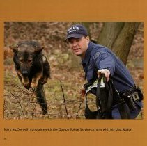 Image of Constable with Guelph Police Services, with his dog, Major, page 24