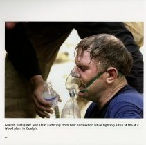 Image of Guelph Firefighter Neil Klein suffering from heat exhaustion, page 40