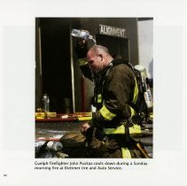 Image of Guelph Fire Fighter at a fire at Dettmer Tire and Auto Service