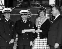 Image of Norma Walker with City Manager Wright and Firemen
