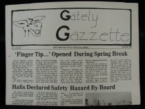 Image of Rectangular, (43.4 x 29 cm) 4 page, black and white high school newspaper. When completely opened the width is 58cm. The font is in the black and the newspaper itself is a grayish yellow color. Drawing of a donkey on the top left corner next to the title, Black and white photo of a dumpster truck on the middle right hand side and a black and white photo of a mushroom cloud from an explosion on the bottom left.   - Newspaper