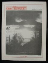 Image of Rectangular, 12 page, black and white high school newspaper. The front page has a red outline, the title is in red on the top left/middle side next to a small drawing of a school and there is a black and white photo of a sunset in December behind a wire fence and the silhouette of some trees. The back page has a short article underneath a black and white picture of a teacher (Dr. Reitz) in an office, standing next to a typewriter.  Layout is slightly different from most newspapers. The front page and the last page are on the same leaf and they run horizontally, the rest of the pages run vertically. When folded in half the front page or the back page is it 29 x 21.8cm. When combining the front and back page, the dimensions are 29 x 43.5 cm. When opened completely the width runs at 58 cm across  Issued by Aurora Central High School. Vol. 30, No. 6 - Newspaper