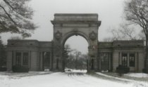 Image of Main Street Entrance Gates and Gatehouse, in winter.  - Print, Photographic