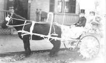 Image of Children Riding in Pony Cart - 1974.02.0025