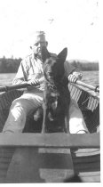 Image of Wendell Volk Rowing with his Dog - 2006.23.0030