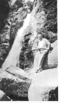 Image of Wendell Volk by a Waterfall - 2006.23.0040
