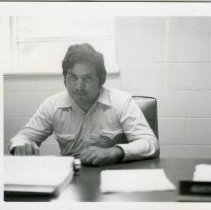 Image of Agustin Alejandro, Director of Computer Center, at his desk.