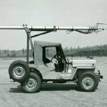 Image of Jeep Carrying Telescoping Radio Antenna - 2013.024.311