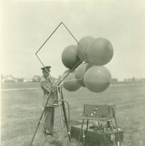 Image of Soldier Holding Weather Balloons - 2013.024.330