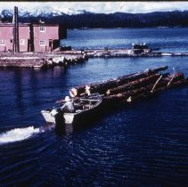 Image of Small Boat Pushing a Log Raft - 2011.014.178