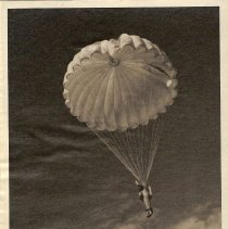 Image of Smokejumper and Parachute in Sky   - 2007.016.019