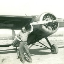 Image of Man Standing beside Single-Engine Airplane - 2007.016.123