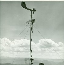 Image of Fire Scientist Using Instrument on Mountain Top