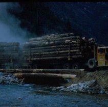 Image of Log Truck Crossing Temporary Log Timber Bridge - 2017.079.047