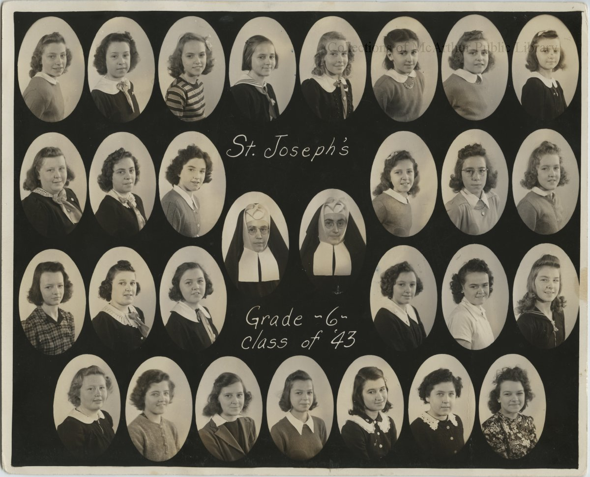 Class portrait showing the 6th grade class of St. Joseph's School, Biddeford for 1943. 27 girls and 2 nuns in habits.