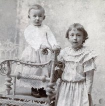Image of Two young children with whicker chair - Photograph Collection