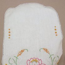 Image of Two samplers, oval, orange, pink and green thread. 