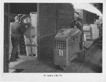 Image of Loading A Box Car