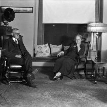 Image of Mr. & Mrs. J.L. Totten in Totten home - 05/17/1925