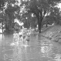 Image of Teenagers wading in flood - 07/24/1938
