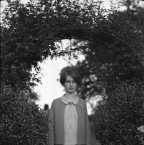 Image of Dorothy Totten under arbor - 03/31/1927