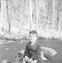 Image of Howard Zimmermann Sitting on Rocks 616 319