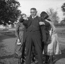 Image of Man in suit and four women - ca. 1920