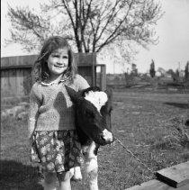 Image of Rhea Wade with Calf (4) - 04/24/1938