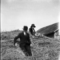 Image of Sitting in a haystack - ca. 1920