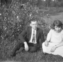 Image of Elton and Sarah, next to bush - ca. 1920