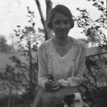 Image of Sarah and dog, sitting - ca. 1920