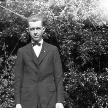 Image of Elton in front of hedge - ca. 1920