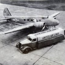 Image of 11x14 B/W photo of UAL Boeing 247 being refueled - 1999.200.18