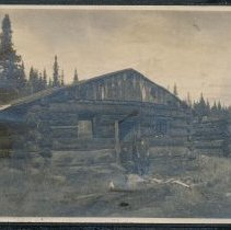 Image of Log Cabin in Field