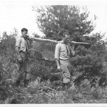 Image of 3900 - Carrying a Beaver Kit in a Live Trap