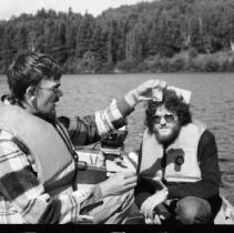 Image of 4392 - Lake survey crew measuring the dissolved oxygen content at various depths, 1977.