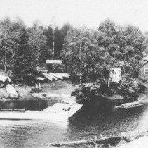 Image of Store at Joe Lake.  The boat from Arowhon is in the foreground.