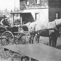 Image of 17 - J.R. Booth team and democrat delivering mail at the railway section house at Coristine.