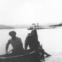 Image of 20 - J.R. Booth alligator at Kiosk with Cyril Stringer and Rose Thomas in foreground.