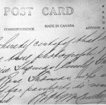 Image of 33 - Back of Thomas family passport photo.