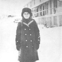 Image of 1916. - Rose Thomas in front of Mowat Lodge on Canoe Lake, winter 1916.