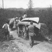 Image of 62 - The Hayes Party fishing trip portaging canoes on a wagon.